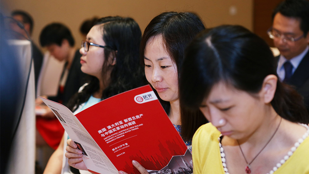 Chinese buyers looking at Juwai brochure