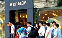 Chinese queuing in front of Hermès shop